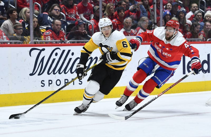 Pittsburgh Penguins defenseman John Marino (6) carries the puck as Washington Capitals right wing Tom Wilson (43) chases during the first period at Capital One Arena.
