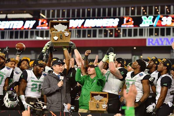 Marshall celebrates winning the 2018 Gasparilla Bowl.