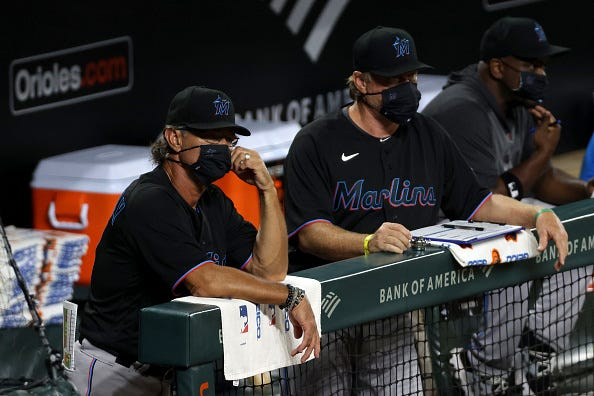 Dan Mattingly watches from the Marlins dugout