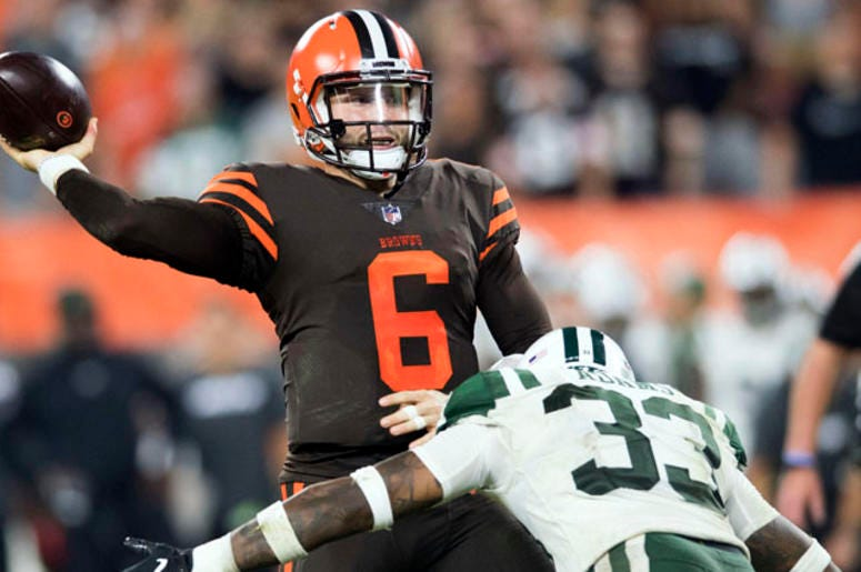 Browns quarterback Baker Mayfield throws a pass under pressure against the Jets on Sept. 20, 2018, at FirstEnergy Stadium in Cleveland.