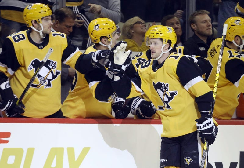 Pittsburgh Penguins center Jared McCann (19) celebrates his goal with the Pens bench against the Florida Panthers during the first period at PPG PAINTS Arena.
