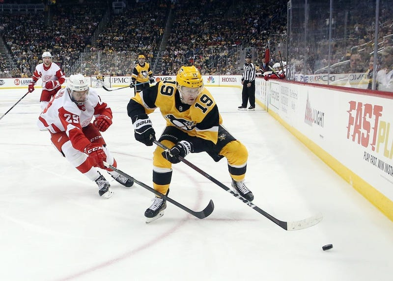 Pittsburgh Penguins center Jared McCann (19) moves the puck ahead of Detroit Red Wings left wing Brendan Perlini (29) during the third period at PPG PAINTS Arena. The Penguins won 5-1.