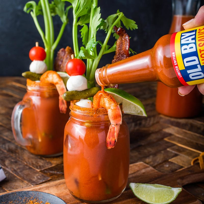 old bay hot sauce dripping in a bloody mary