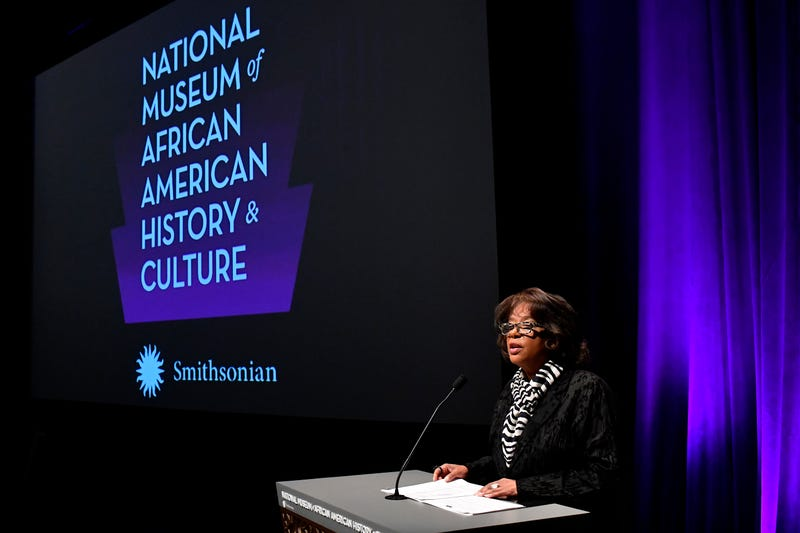 A speaker at the National Museum of African American History and Culture