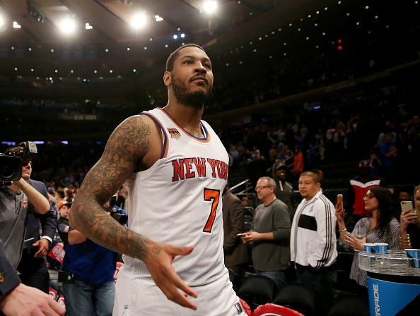 Carmelo Anthony walks off the court at Madison Square Garden.