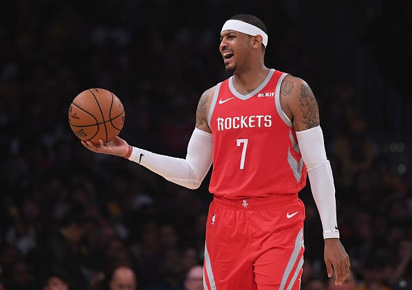 Carmelo Anthony expresses his displeasure with a call while on the Rockets.
