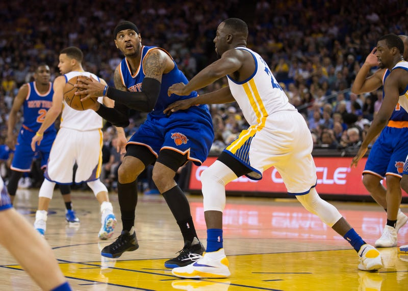 Carmelo Anthony looks to make a play on Draymond Green.