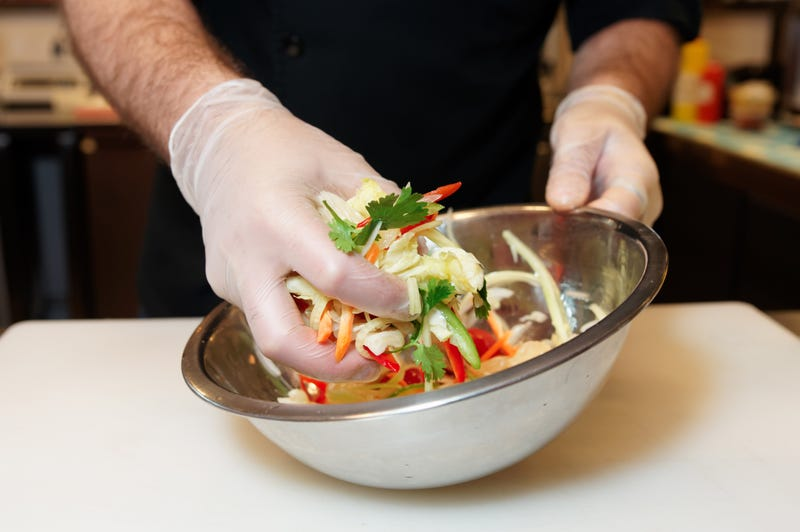 A metal bowl with Asian slaw