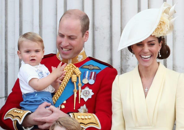 Prince William and Kate Middleton with their son, Prince Louis.