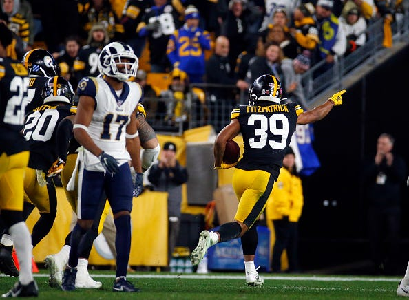 Steelers' Minkah Fitzpatrick returns an interception for a touchdown.