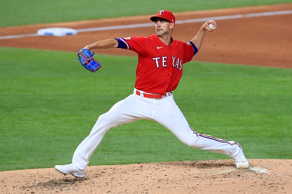 Mike Minor pitches for the Rangers.