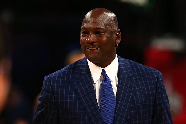 Michael Jordan smiles at the 2016 NBA All-Star Game.