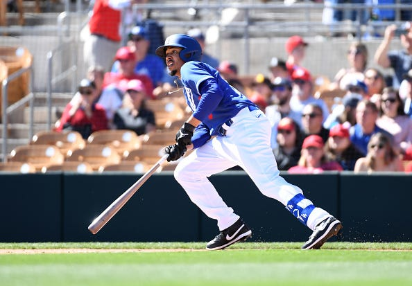 Mookie Betts picks up a hit in a Dodgers spring training game.