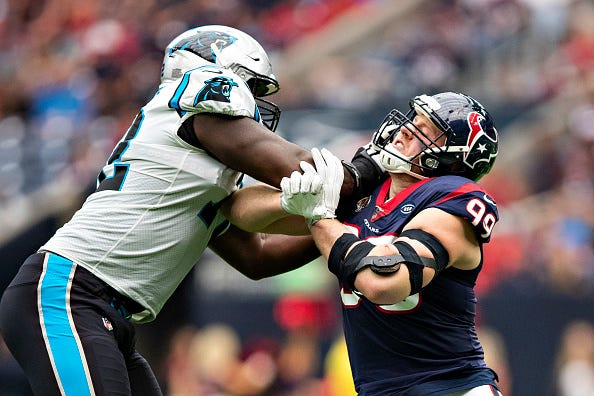 Taylor Moton stuffs J.J. Watt at the line of scrimmage.