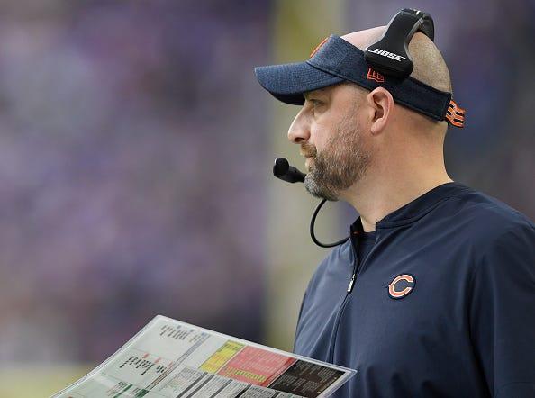 Bears head coach Matt Nagy relays the play call to the offense.