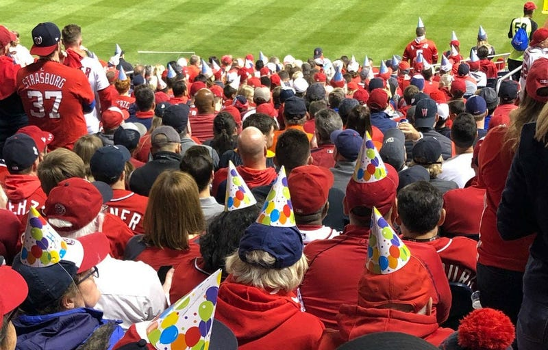 Nationals fans wear birthday hats for Juan Soto at Game 3 of the World Series at Nats Park.