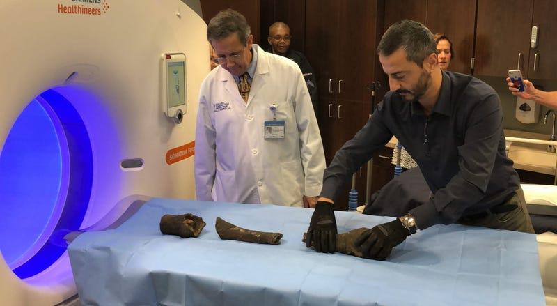 Mummified bones of Queen Nefertari prepare to be scanned by CT.