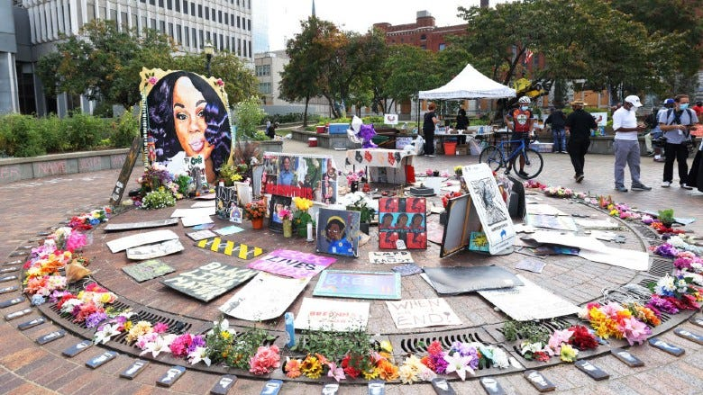People visit a makeshift memorial for Breonna Taylor on September 24, 2020 in Louisville, Kentucky.