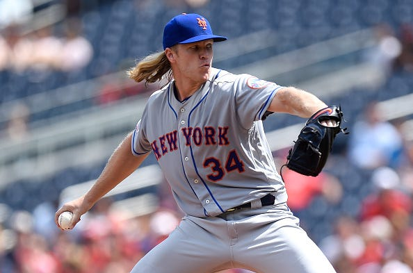 Noah Syndergaard of the Mets pitches against the Nationals.
