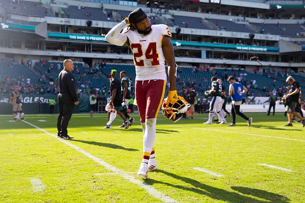 Josh Norman walks off the field in a game against the Eagles.