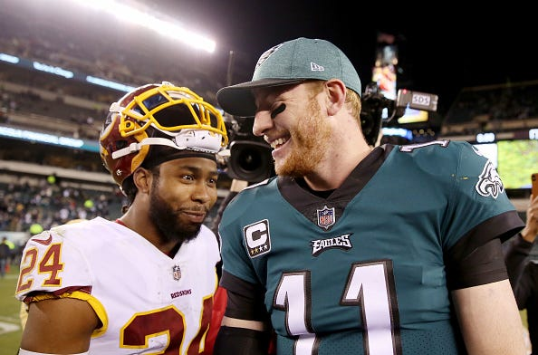 Redskins CB Josh Norman greets Carson Wentz after a game.