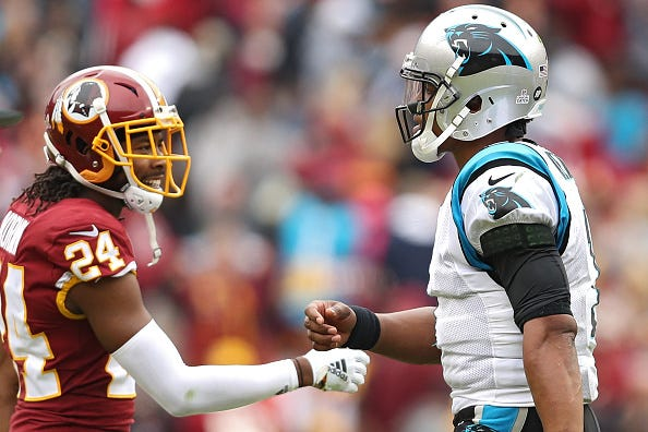 Josh Norman daps up Cam Newton before a game vs. the Panthers.