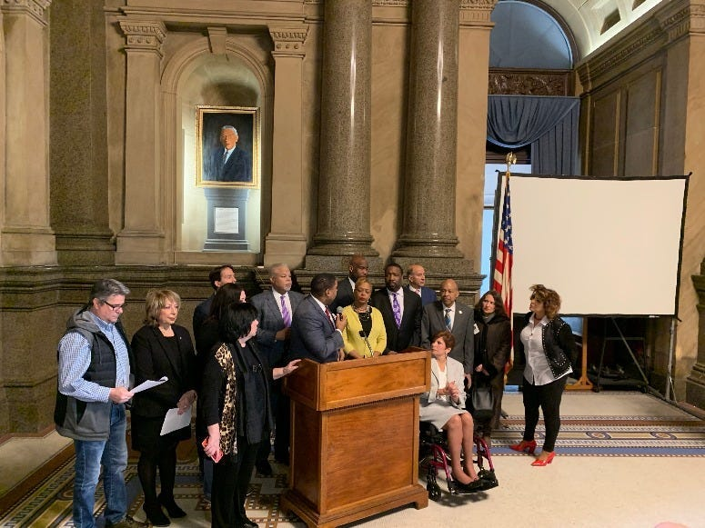 Neighbors joined a dozen state lawmakers and City Councilmembers at a news conference to announce three separate bills aimed at safe injection sites.