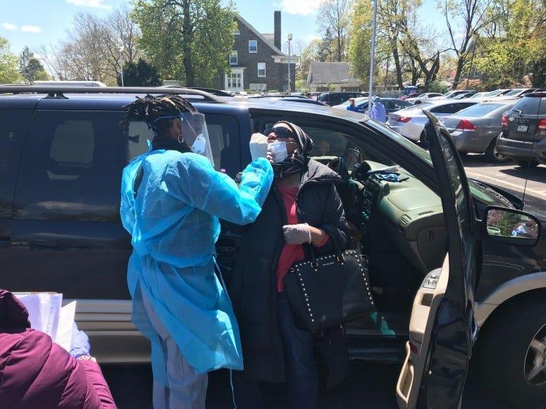 Dr. Octavia Pickett Blake, a volunteer with the Black Doctor COVID-19 Consortium, doing coronavirus tests.