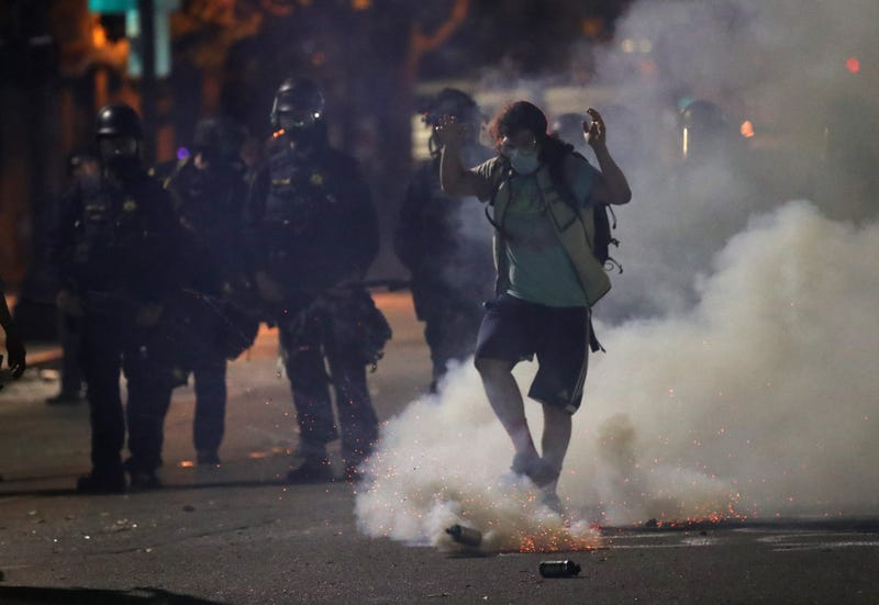 Tear gas used on a protestor in Oakland