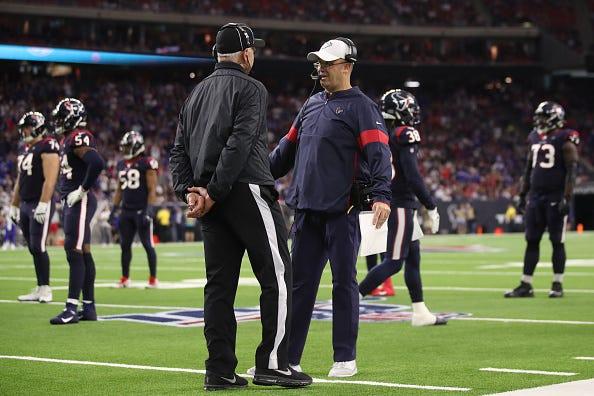 Texans coach Bill O'Brien argues the call on the field.