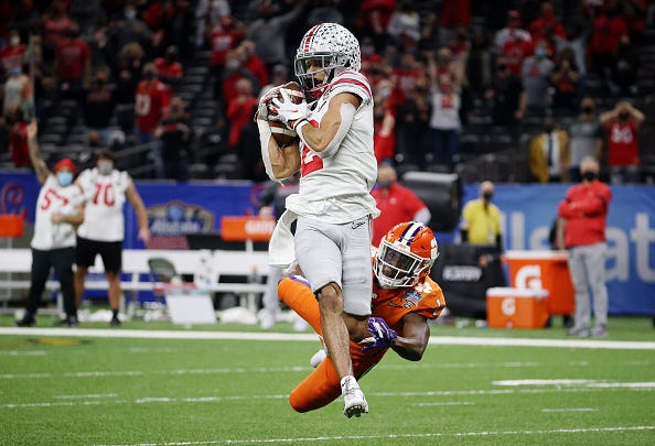 Chris Olave hauls in a catch for Ohio State