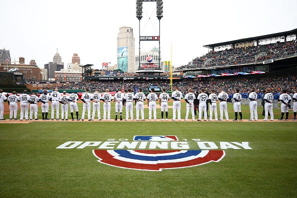 Detroit Tigers players stand for the national anthem on Opening Day 2019.