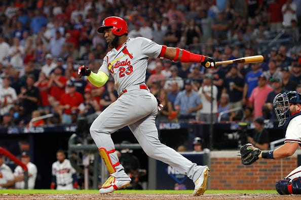 Marcell Ozuna rips a line drive against the Braves.