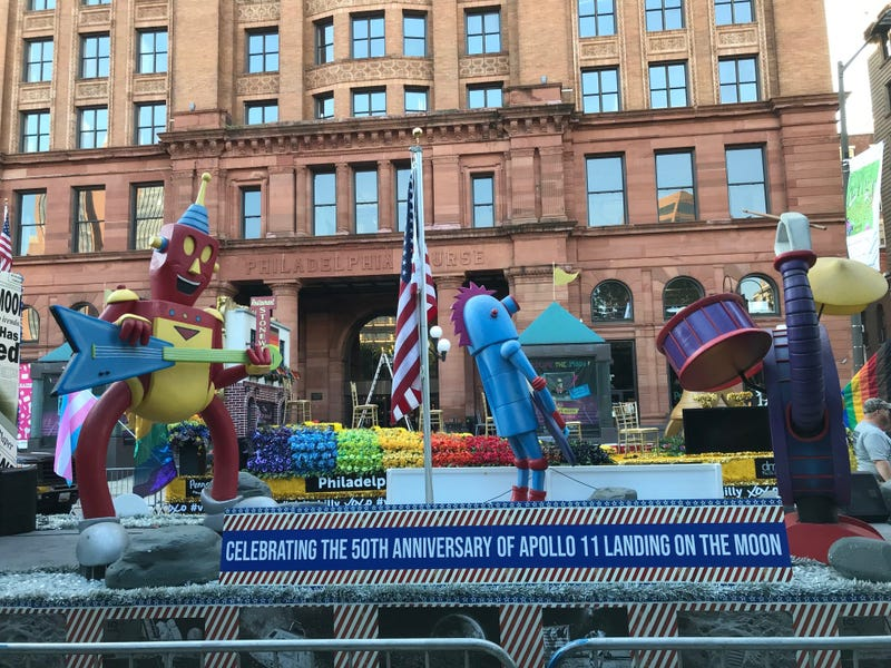 Floats begin to line up for the Independence Day Parade.
