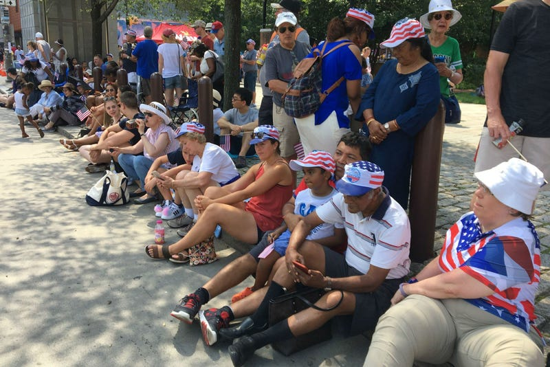 People wait along Independence Mall in Philadelphia for the 2019 Independence Day Parade to start.