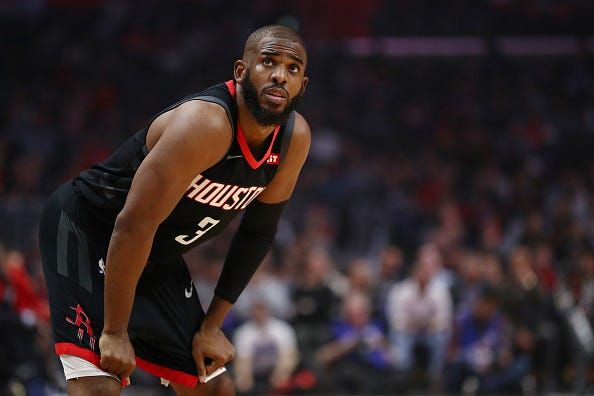 Chris Paul looks on during a game with the Rockets.