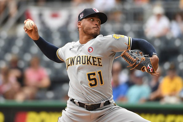 Freddy Peralta pitches for the Brewers