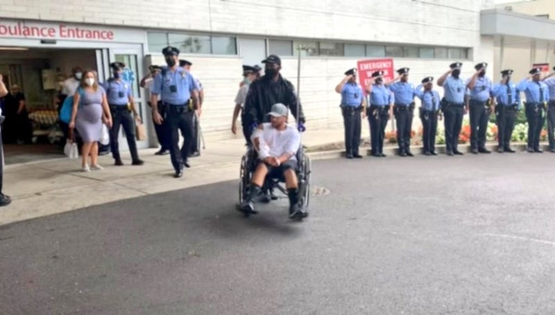 Philadelphia police officer Arcenio Perez, being taken in a wheelchair from Penn Presbyterian Medical Center after his recovery from being shot during an exchange of gunfire on October 4.