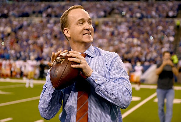 A retired Peyton Manning still tosses the football before a game.