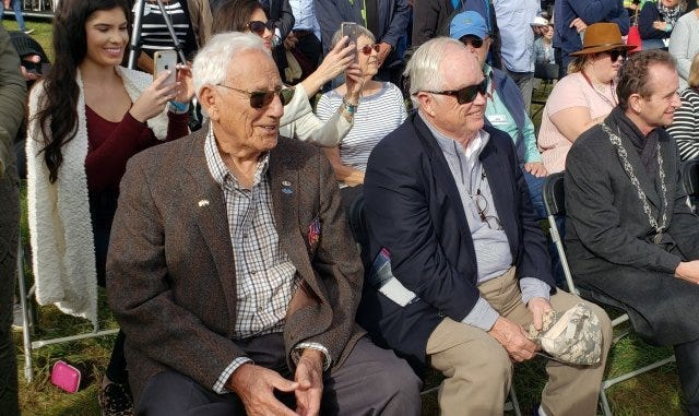 Gene Metcalfe and Richard Blankenship sit as guests of honor before receiving the Military Order of William Orange Lanyard, the Netherlands highest award,