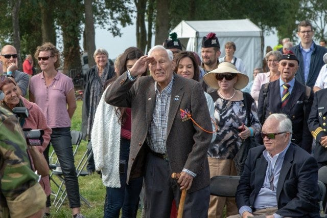 Gene Metcalfe, a World War II veteran and former POW, salutes the crowd after being awarded the Military Order of William in Groesbeek, Netherlands,