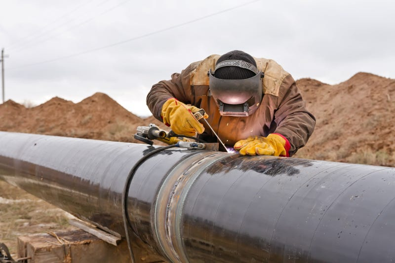 Welder works on pipeline