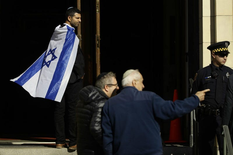 Mourners gather outside Rodef Shalom Congregation during the funeral services for brothers Cecil and David Rosenthal, Tuesday, Oct. 30, 2018, in Pittsburgh.