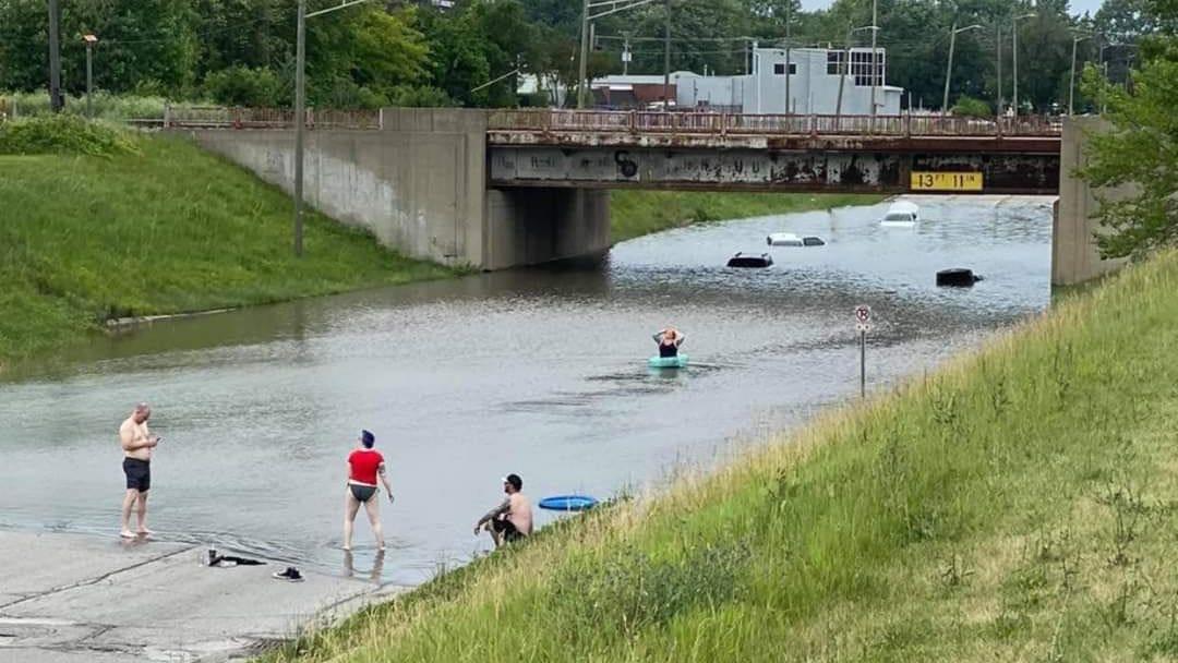 Authorities issue warning after people in shorts and bikinis swim sewage-flooded Detroit freeways [PHOTO]