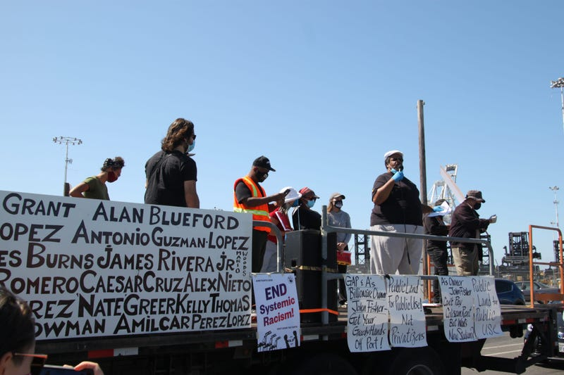 ILWU Local 10 members rally for workers' rights and an end to systematic racism at the Port of Oakland.