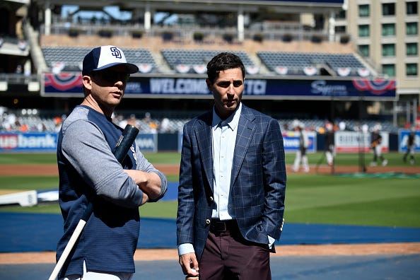 Padres GM A.J. Preller (r.) talks with former manager Andy Green.