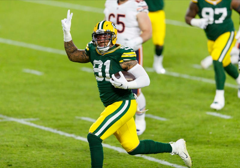 Nov 29, 2020; Green Bay, Wisconsin, USA; Green Bay Packers outside linebacker Preston Smith (91) returns a fumble recovery for a touchdown during the second quarter against the Chicago Bears at Lambeau Field. Mandatory Credit: Jeff Hanisch-USA TODAY Sports