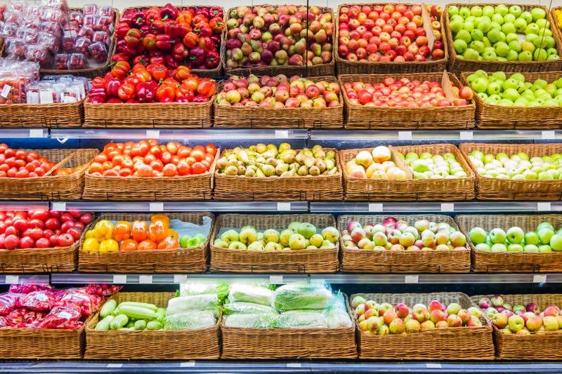 Fresh fruits and vegetables on shelf in supermarket