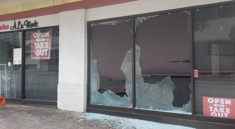 A broken shop window on the country club plaza the day after being smashed during a demonstration