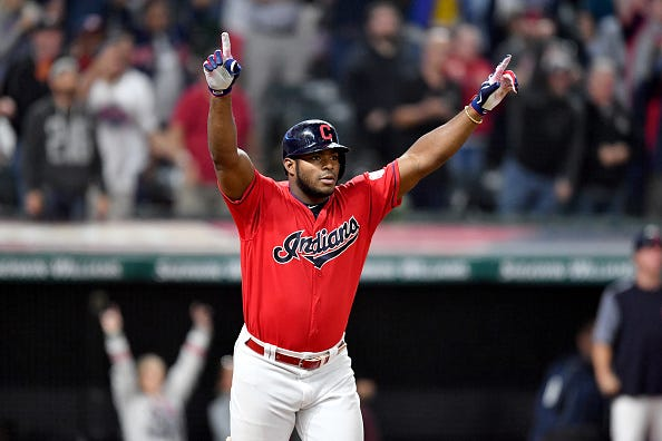 Cleveland's Yasiel Puig admires his hit
